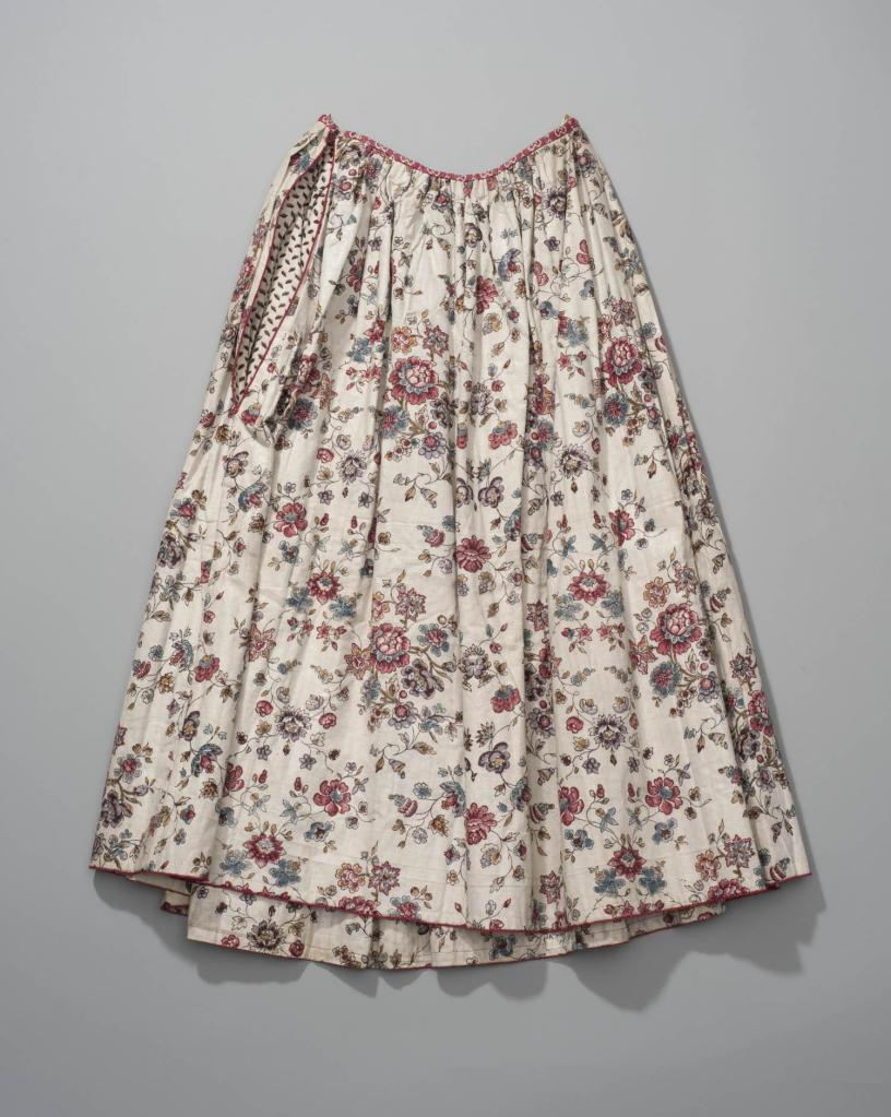Petticoat. Many were made out of chintz fabric. There are also some examples of solid color quilted petticoats.